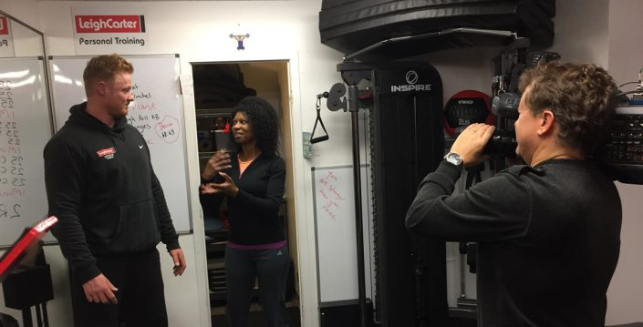 Leigh Carter being filmed for a fitness television show
